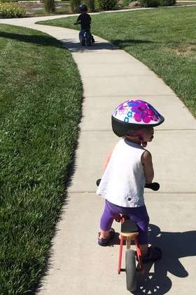 1 year old girl on balance bike